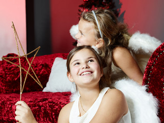 Two girls wait for Christmas Eve