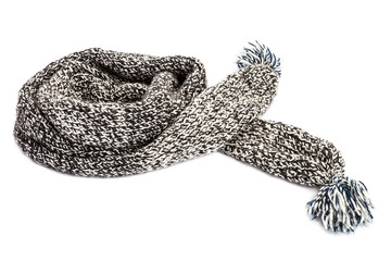Striped knitted woollen scarf on white background.