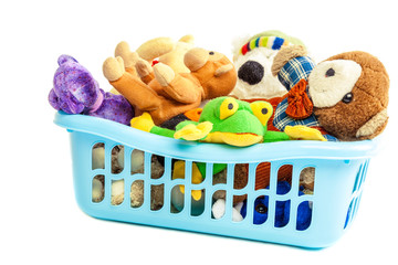 Soft toys in a plastic container on white background.