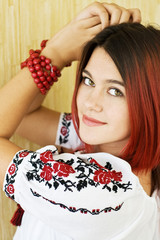 Beautiful Ukrainian girl in traditional embroidered shirt
