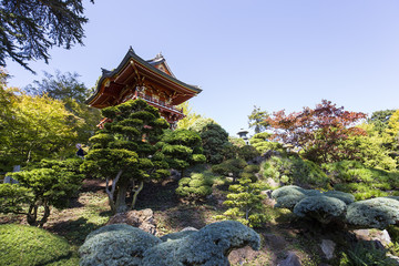 red  pagoda in a japanese garden
