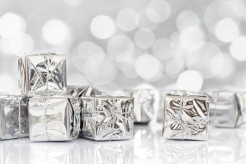Small Christmas gifts in shiny silver paper