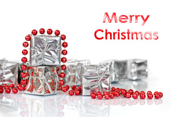 Merry Christmas gifts in shiny silver paper