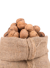 Walnuts in burlap bag.