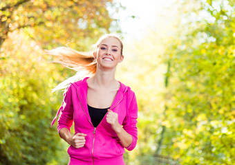 young blonde girl jogging
