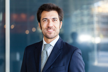 Handsome smiling business man portrait