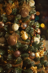 Decorated Christmas tree in brown and golden colors