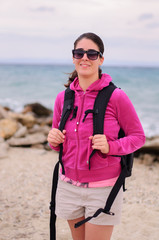 Young woman with backpack on a beach