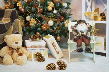 Toys and gift boxes by the decorated Christmas tree