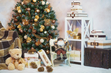 Festive interior decoration for Christmas in gold and brown