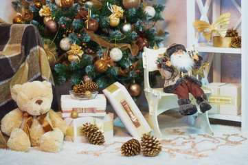 Decorated Christmas tree, toys and box presents