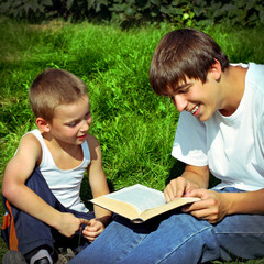Brothers reads a Book