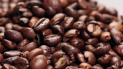 Pile of roasted coffee beans,rotating