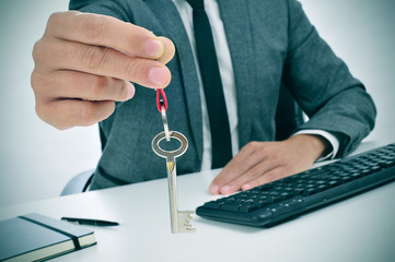 man in an office giving a key