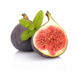 Two sliced figs with mint isolated on white background