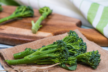 fresh green broccolini on table