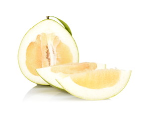 Three pomelos,half,quarter isolated on white