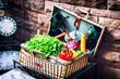 Old picninc basket with fresh vegetables