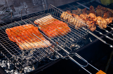 salmon and pork kebabs grilling