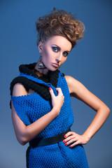 beautiful blonde woman wearing blue dress