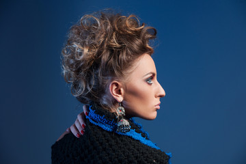 Profile portrait of woman with fashion hairstyle.