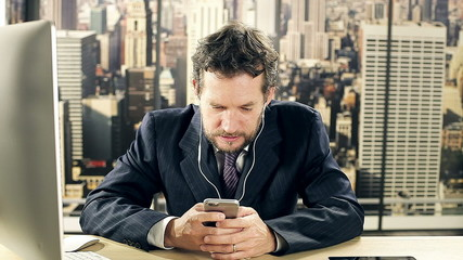 Business man writing text message