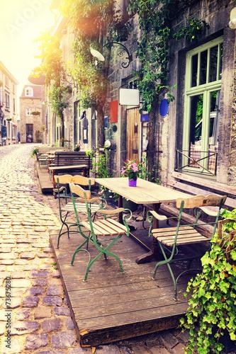 Leinwandbild Motiv Cafe terrace in small European city