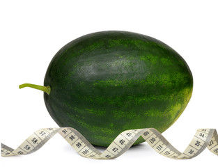 Fresh green melon with measuring tape