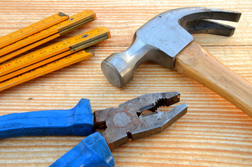 Claw hammer, carpenter meter and pliers