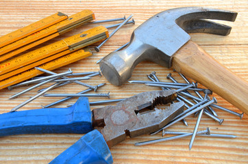 Claw hammer, carpenter meter, pliers and nails