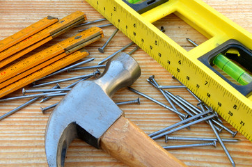 Claw hammer, carpenter meter, water-level and nails