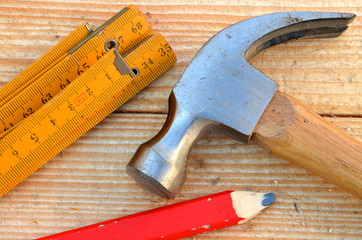 Claw hammer, carpenter meter and pencil