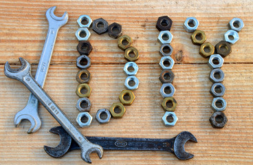 DIY (do it yourself) text from small nuts and spanners