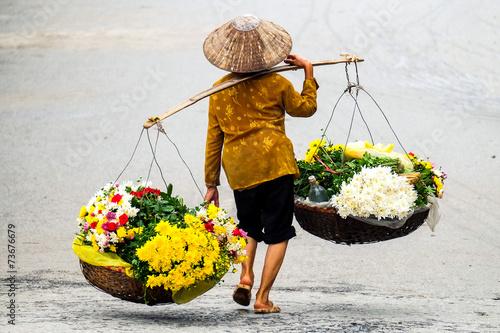 Leinwanddruck Bild Life of florist vendor at small market in HANOI,vietnam