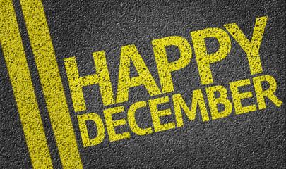 Happy December written on the road