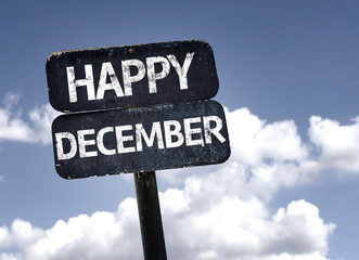 Happy December sign with clouds and sky background