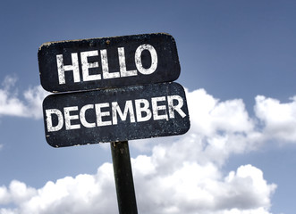 Hello December sign with clouds and sky background