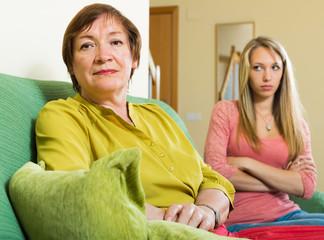 adult daughter and mother having quarrel