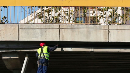 Maintenance Worker on Elevated Road