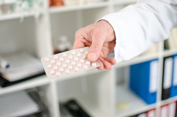 Doctor holding a blister pack of pills