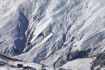 Speed flying in snow mountains in sunny nice day