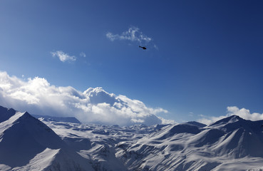 Helicopter above snowy plateau