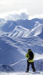 Snowboarder on off-piste slope