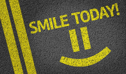 Smile Today with a Happy Smiley written on the road