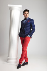 fashion man posing near white column