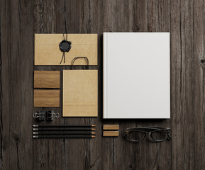 Stationery elements on wood background