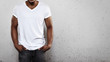 Leinwandbild Motiv Young man wearing white t-shirt