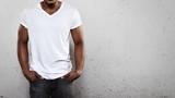 Photo: Young man wearing white t-shirt