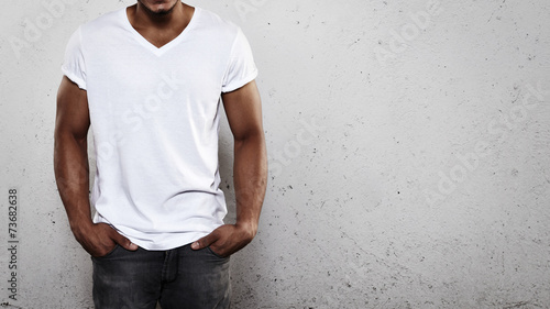 Leinwanddruck Bild Young man wearing white t-shirt