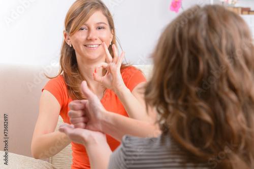 Leinwanddruck Bild Deaf woman learning sign language